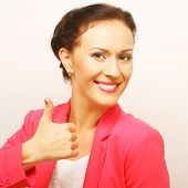 Successful businesswoman gives thumb up