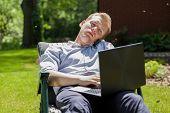 Businessman Sitting In Garden