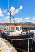 stock photo of galway  - Moored fishing boat in Letterfrack in County Galway - JPG