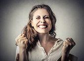 Young woman jubilating