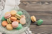 macaroons on wooden background