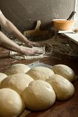 Fresh original Italian raw pizza, dough preparation in traditional style.
