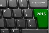 Close-up of computer keyboard with  green twenty fifteen new year key