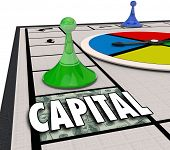 Capital word on a board game with piece moving forward to win financing and funding for a new startup business or company venture