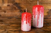 Bloody candles for Halloween holiday, on wooden background