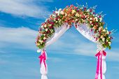 wedding arch, cabana, gazebo on tropical beach decorated with flowers, beach wedding decoration