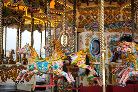 stock photo of carousel horse  - Brightly painted horses on a vintage carousel or merry - JPG