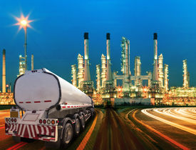 picture of trucks  - petroleum container truck and beautiful lighting of oil refinery plant in heav petrochemicaly industry estate use for power energy and petroleum industrial topic - JPG