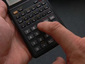 stock photo of statistician  - Finger working calculator - JPG