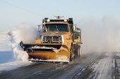 stock photo of illinois  - Snow plower on rural road in Illinois - JPG