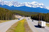 picture of semi-truck  - Semi truck on the road in Banff National Park - JPG