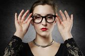 picture of seducing  - Beautiful seducing femme fatale in nerdy glasses - JPG