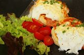 picture of benediction  - Eggs Benedict vegetable eggs on a black plate - JPG