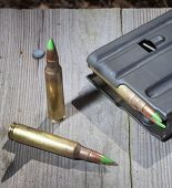 image of piercings  - Pair of cartridges that allegedly pierce armor and a magazine - JPG