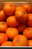 stock photo of clementine-orange  - Lot of orange mandarins in a wooden pack