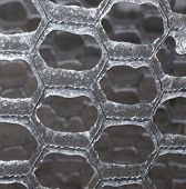 stock photo of chicken-wire  - Thin wire fence that is coated with thick ice - JPG