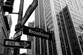 stock photo of broadway  - Broadway cross roads with arrows black and white - JPG