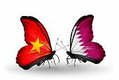 stock photo of qatar  - Two butterflies with flags on wings as symbol of relations Vietnam and Qatar - JPG