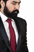 foto of coat tie  - man wearing tuxedo with neck tie while posing - JPG
