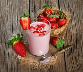 picture of yogurt  - Strawberry yogurt in a glass with fresh strawberries on a wooden table - JPG