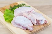 foto of thighs  - Raw chicken thighs with salad leaves and ruccola - JPG