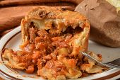 picture of baked potato  - Gourmet steak and ale pie with a baked potato - JPG