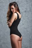 pic of leotards  - beautiful woman in black leotard posing on grey background - JPG