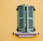 picture of green wall  - italy abstract window green in the yellow wall - JPG