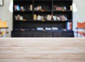 foto of book-shelf  - Top of Wooden Table with Blurred Book Shelf Interior Background - JPG