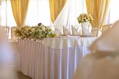 pic of wedding table decor  - Tables set and salad served for a wedding reception - JPG