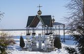 foto of canopy roof  - The Canopy on cross in Bogoyavlenskom Mstyorskom male priory on background blue sky.Russia