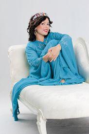 stock photo of yashmak  - Beautiful Adult arabian woman in blue abaya - JPG