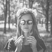 picture of dandelion  - Smiling beautiful girl in wreath of dandelions closed her eyes with dandelions in summer park concept of summer mood. Black and white image ** Note: Visible grain at 100%, best at smaller sizes - JPG