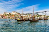 foto of old boat  - Porto and old traditional boats with wine barrels in Portugal in a summer day - JPG