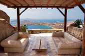 Veranda With Wicker Furniture In A Hotel Overlooking The Sea And Islands