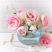 picture of blue rose  - Background with sweet pink roses flowers in blue vase on white painted wooden background. Selective focus. Place for text. Square image. ** Note: Shallow depth of field - JPG