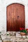 pic of greek-island  - Wooden door and red geranium in pot greek traditional house at Corfu island - JPG