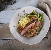stock photo of mashed potatoes  - Steak With Mashed Potatoes And Sugar Peas - JPG