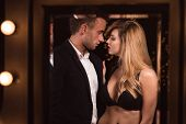 picture of half-naked  - Image of a half naked female seducing a handsome man - JPG