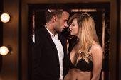 image of seducing  - Image of a half naked female seducing a handsome man - JPG