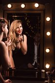 picture of seducing  - Image of a sexy smiling woman seducing a man - JPG