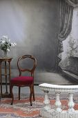 stock photo of balustrade  - typical old photostudio with chair table flowers and a marble balustrade - JPG