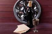 stock photo of matzah  - Matzo for Passover with metal tray and wine on wooden background - JPG