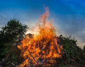 image of bonfire  - Big bonfire against blue  sky - JPG