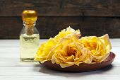 foto of fragrance  - Yellow rose blossoms in wooden bowl - JPG
