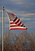 stock photo of virginia  - American flag turning atop the Blue Ridge overlooking the Shenandoah Valley in Virginia - JPG
