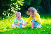 picture of girl toy  - Children playing in the garden - JPG