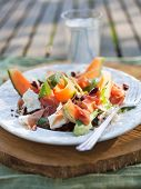 stock photo of cantaloupe  - Cantaloupe salad with mozzarella and rucola - JPG