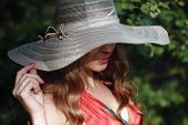 foto of incognito  - incognito girl in a hat and red dress