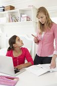 picture of homework  - Unhappy Mother Telling Off Daughter For Not Doing Homework - JPG